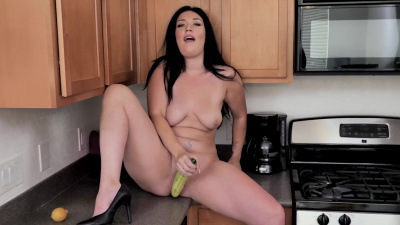Stepmom Megan Maiden rubbing her clit and stuffing herself with cucumber