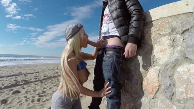 Big Booty Blondie Fesser gets her pussy cock filled on a public beach